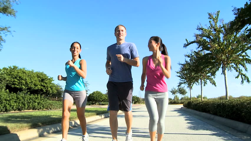Group of young people jogging on suburban roads for sporting event - HD stock footage clip