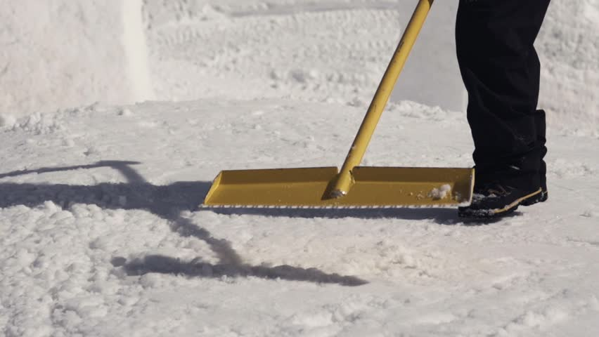 Men clear snow on slope by shovel at ski resort. Sunny day. Mountain. Spraying. Snowdrift. Slow motion. Close up | Shutterstock HD Video #19188490