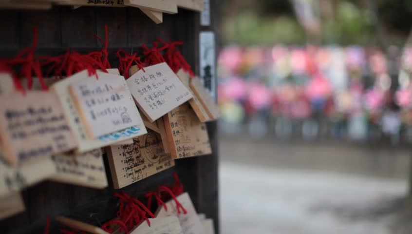 Wooden prayer tablets in a Japanese shrine in Tokyo, Japan - HD stock footage clip