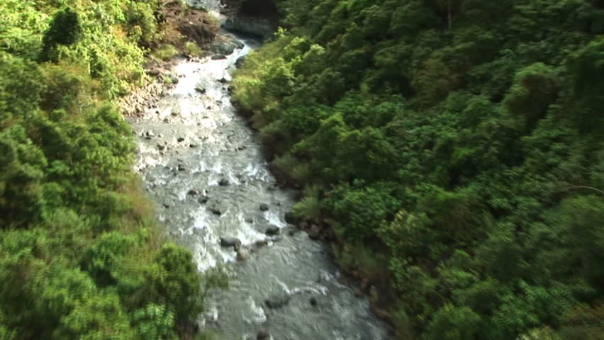 HD: Flying over river and waterfall in the Philippines
