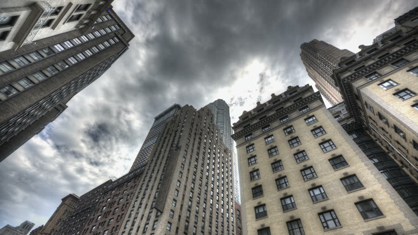 HDR Timelapse of Skyscraper in New York City with dark clouds passing by