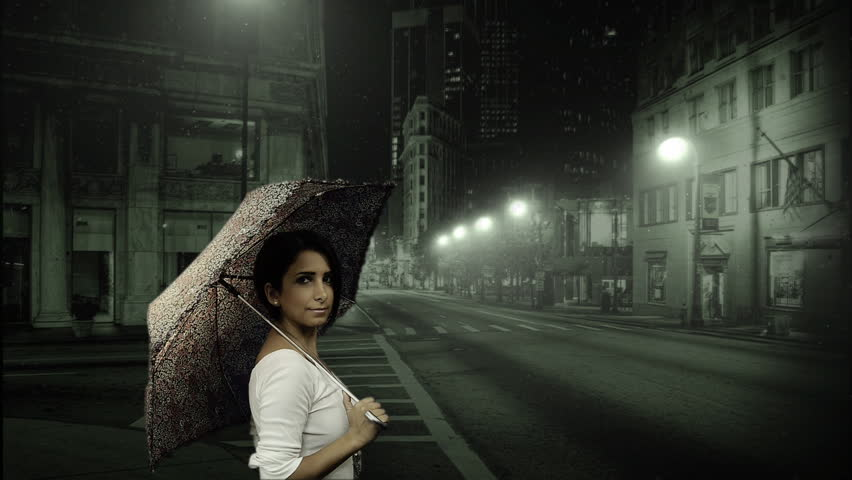 Young woman holding umbrella in snowy street at night - Snowing - Weather - Winter - Portrait - Full HD - HD stock video clip