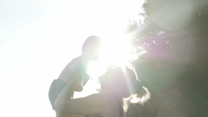 At the evening time before the sunset, 2 years baby feeling happy and smiles with her mother in the garden. | Shutterstock HD Video #19343047