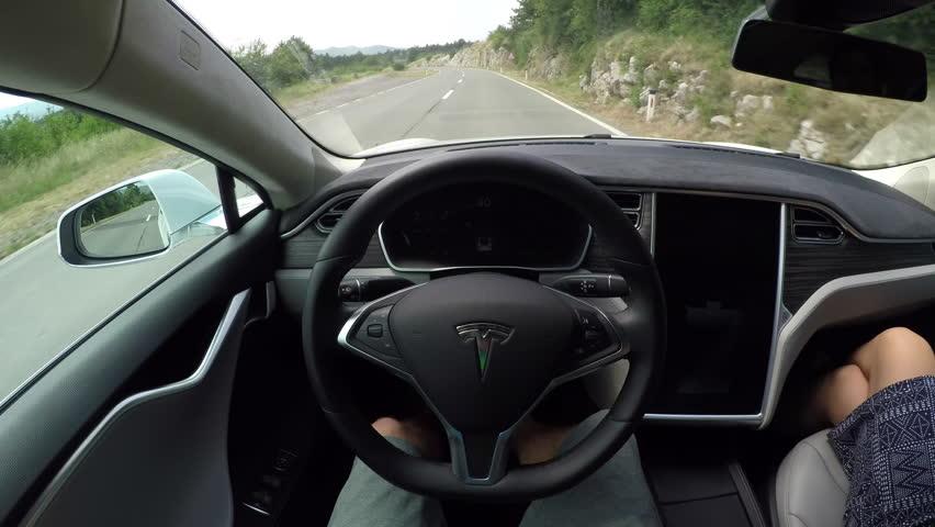 crni kal slovenia july 20 self driving tesla electric car using sensors navigating winding. Black Bedroom Furniture Sets. Home Design Ideas