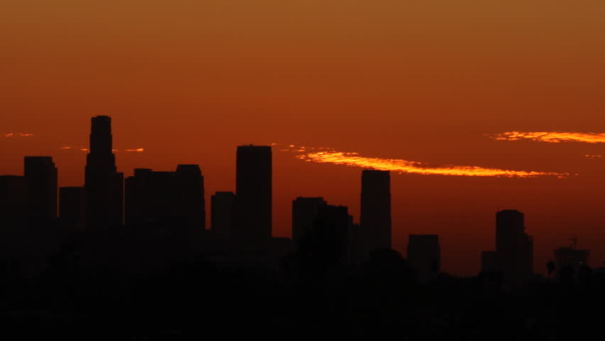 Time Lapse of the sun rising from behind the building of downtown Los Angeles. | Shutterstock HD Video #19385599