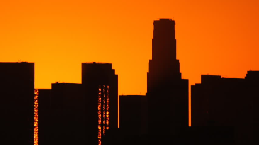 Time Lapse of the sun rising from behind the building of downtown Los Angeles. | Shutterstock HD Video #19385608