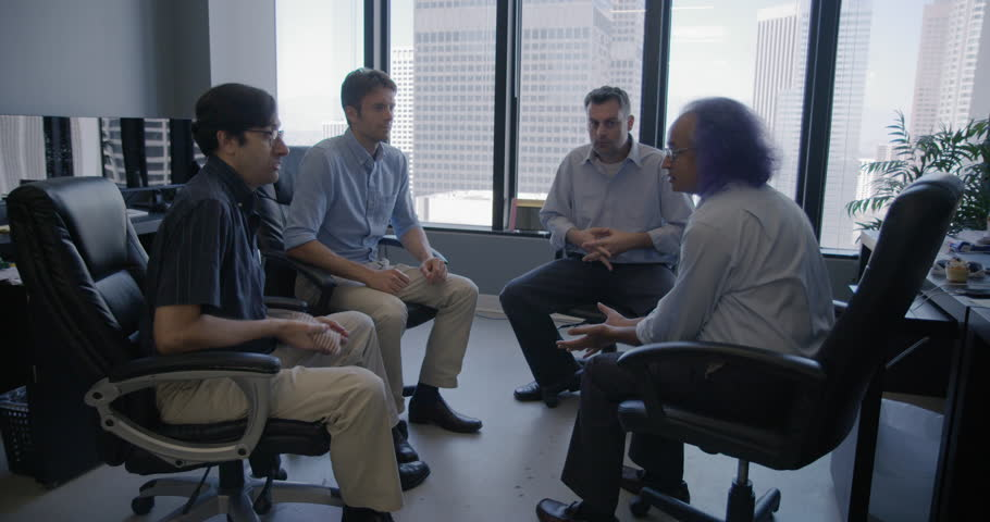 Group of four business men led by creative executive with purple hair throw bean bag to each other in team building exercise in Downtown LA office.  Wide shot, recorded in slow motion at 60fps | Shutterstock HD Video #19463656