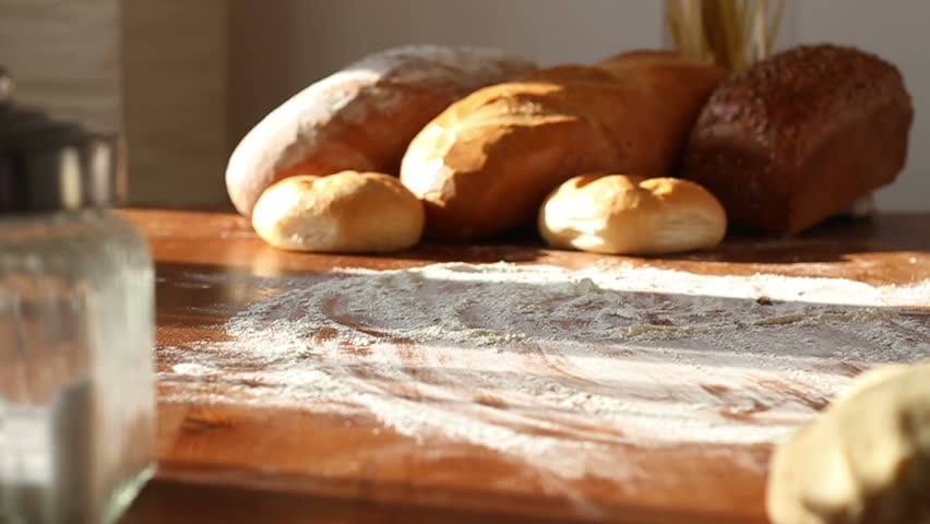 PUTTING BREAD ROLLS ON THE TABLE