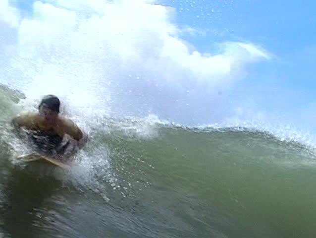Brazilian surfer. Close-up. - SD stock video clip