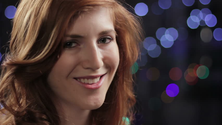 Pretty young red haired woman smiling - HD stock video clip