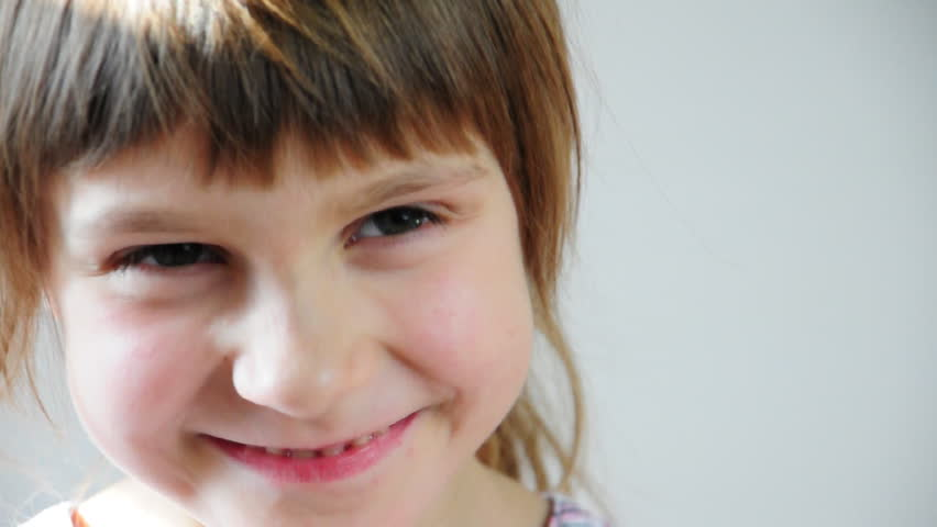 Close-up portrait of a happy little girl bursting in laugh - HD stock video clip