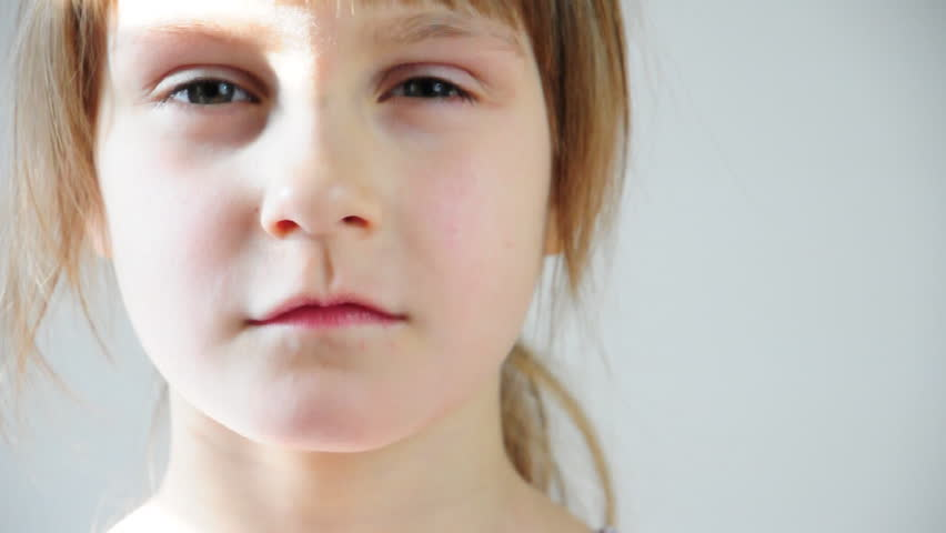 close-up portrait of a serious little girl  - HD stock footage clip