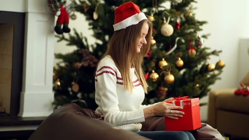 Beautiful smiling girl open christmas gift | Shutterstock HD Video #19548490