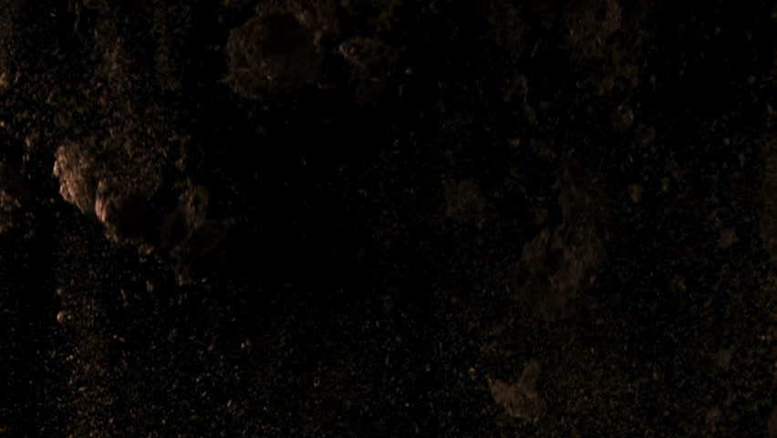High quality motion animation representing various pieces of debris, falling in slow motion, on a black background.  | Shutterstock HD Video #19594930