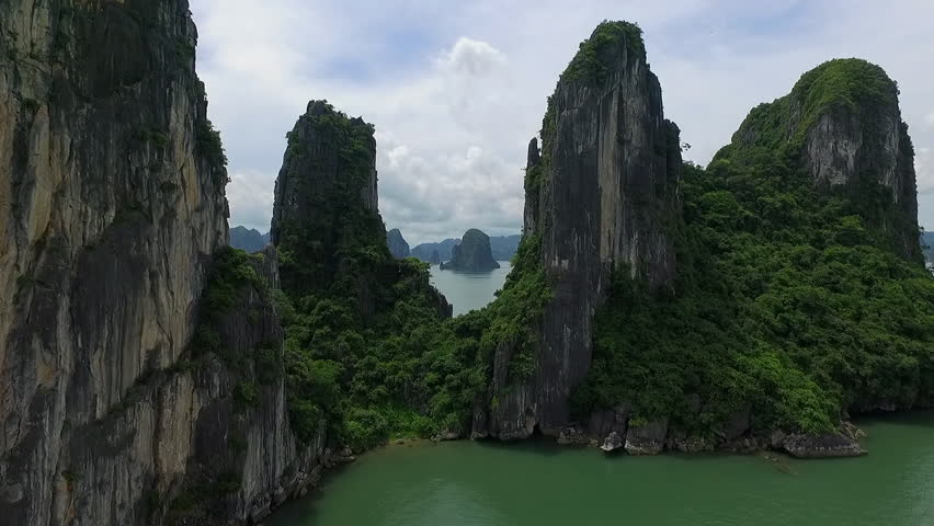 A suggestion aerial video in ha long bay, vietnam. An aerial video near the rocks, in a beautiful day. | Shutterstock HD Video #19601293