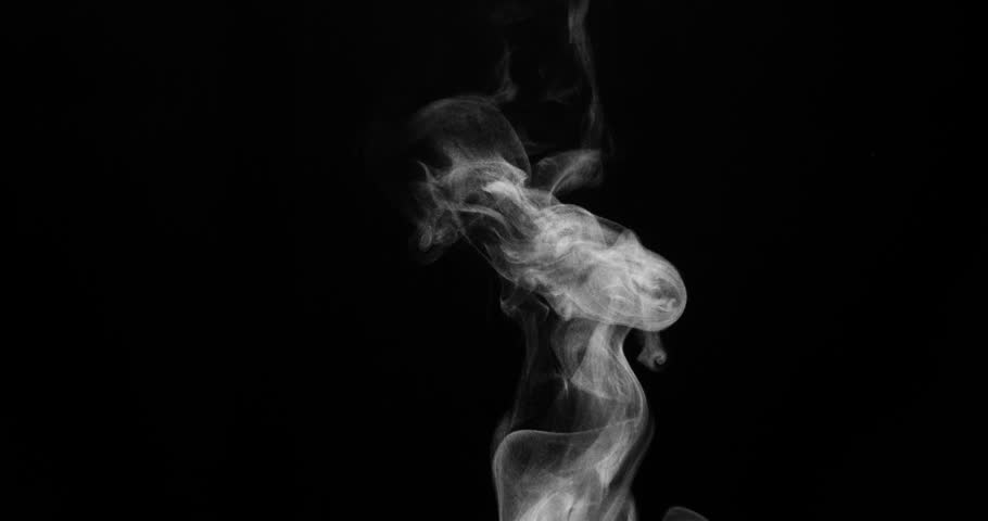 Trickle of Steam Slowly Rising from the Cup. White steam rises light, graceful twists on a black background. Shooting at a rate of 120fps Footage is perfect for the layer with different blending modes
