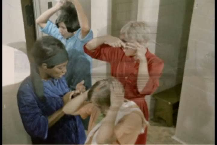 WACs are seen washing their faces and drying their hair in the bathroom in 1971 while narrator explains the importance of daily showering. (1970s) | Shutterstock HD Video #19699726