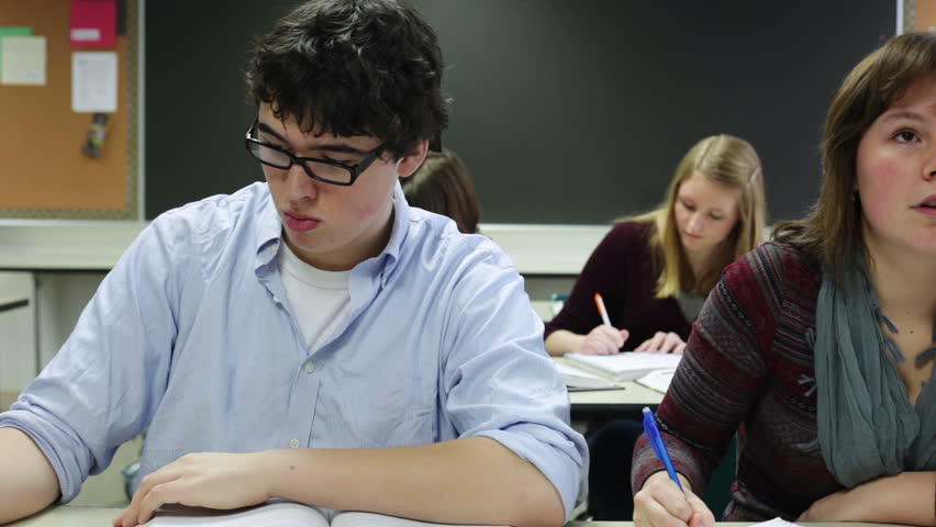 High school students taking notes in classroom - HD stock video clip