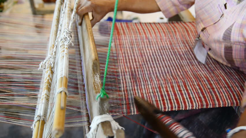 Traditional Thai textile manufacture in craft village, Old women work on wooden weaving thread machines and spin yarn creating cotton fabric. Chaing Mai, Thailand.   | Shutterstock HD Video #19790707
