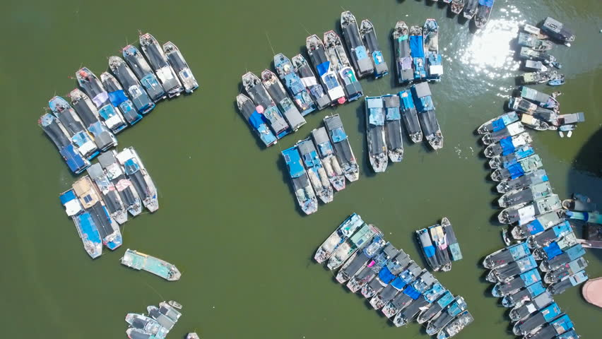 Aerial footage looking down at an old fishing fleet in the harbor of Sanya in the South China Sea. | Shutterstock HD Video #19837606
