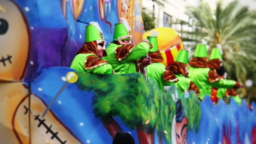 NEW ORLEANS, LA - February 11, 2012:  People in costume on a Mardi Gras float