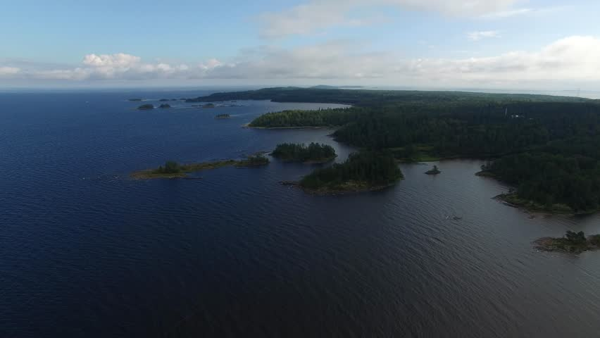 Flying over the rugged coast of the island of Valaam. Ladoga lake. Journey to the Holy places. Aerial view. The landscape of the island of Valaam. | Shutterstock HD Video #19884622