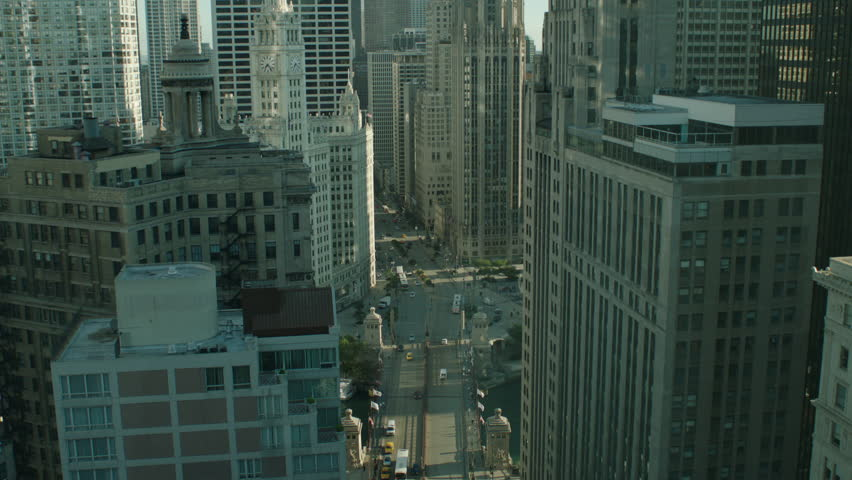 Day hold slightly down across downtown Chicago street Michigan Ave Michigan Bridge city buses taxi cabs cars surrounded Chicago buildings, see Wrigley Building can be window plate | Shutterstock HD Video #19928848