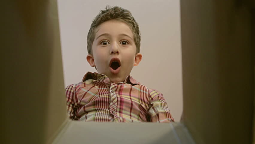 Little boy opens a parcel box with different versions of emotions and being surprised. | Shutterstock HD Video #20185195