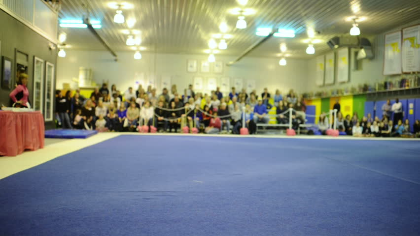 Talented gymnast performs floor exercise during competition.
