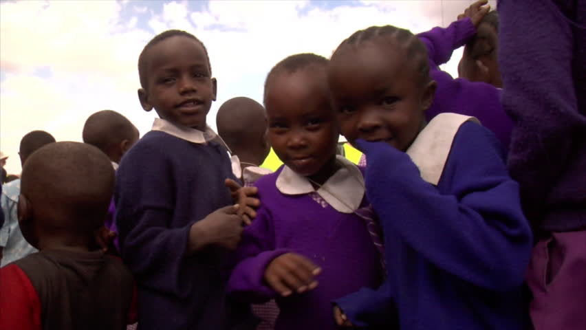 KENYA - CIRCA 2006: Unidentified kids look at the camera turn around circa 2006 in Kenya.