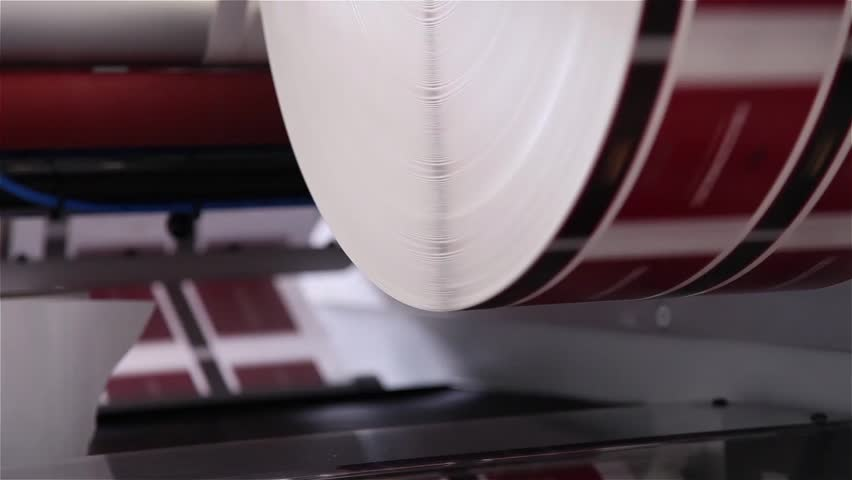 Roll with paper being printed in a printing press | Shutterstock HD Video #20247511