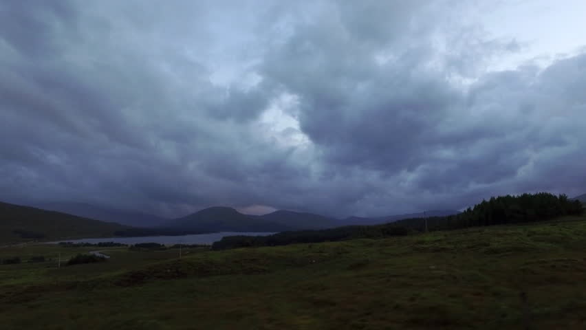 The view out of a car window while driving through the Black Mount with Loch Tulla in the distance. Scottish Highlands. | Shutterstock HD Video #20272333