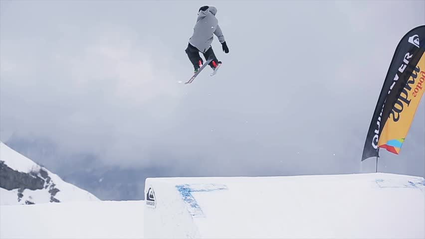 Slow motion snowboarder carving in fresh snow stock