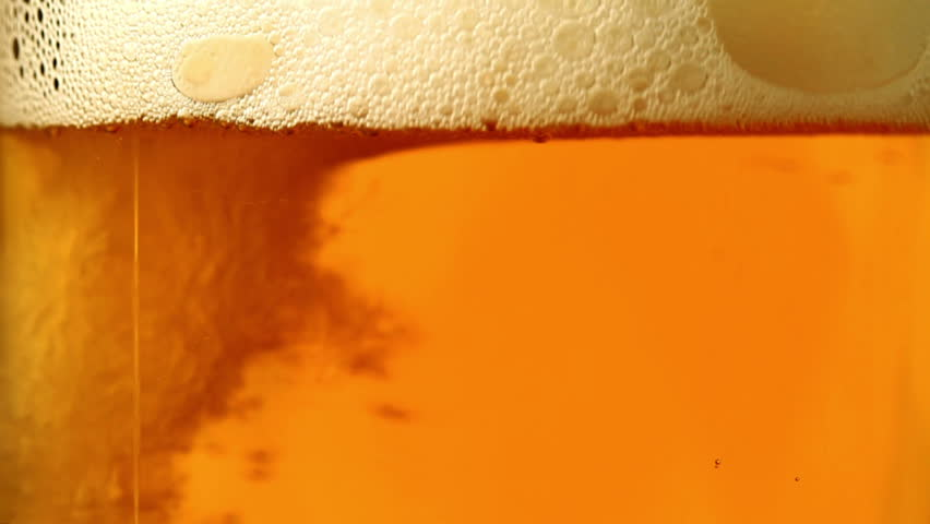 Beer is poured in a glass.