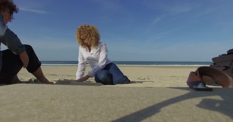 Women walking on the beach | Shutterstock HD Video #20540857