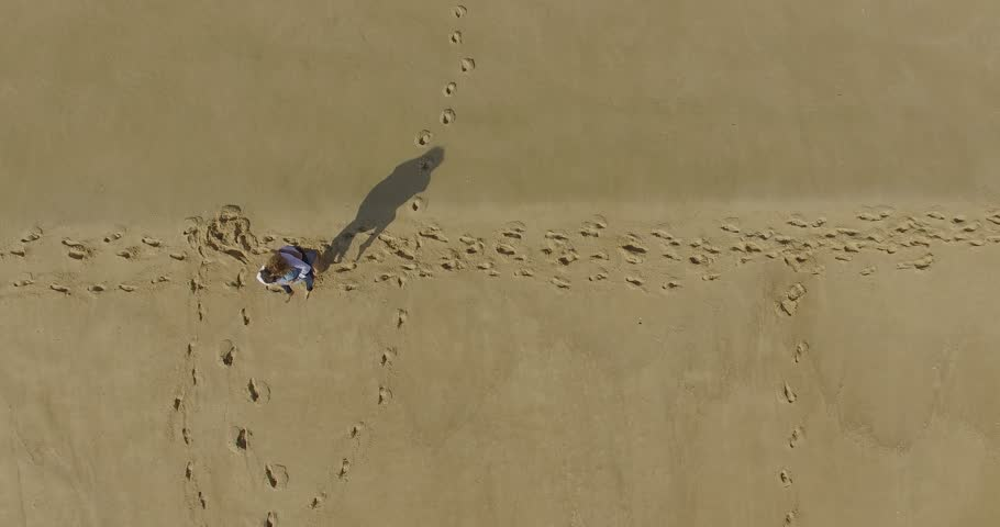 Woman and man on the beach jumping | Shutterstock HD Video #20541109