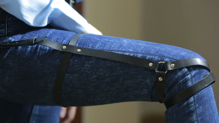 Girl in jeans with leather garter new fashion trends. straps on the hips | Shutterstock HD Video #20546689
