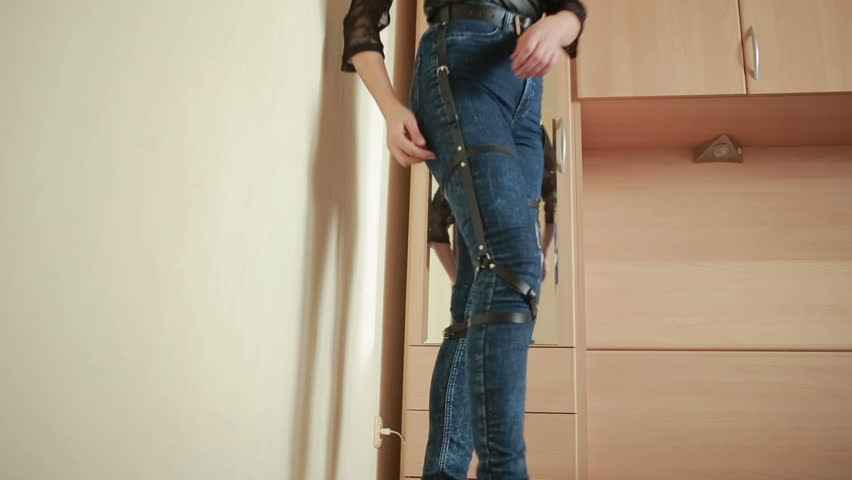 Girl in jeans with leather garter new fashion trends. straps on the hips | Shutterstock HD Video #20546698