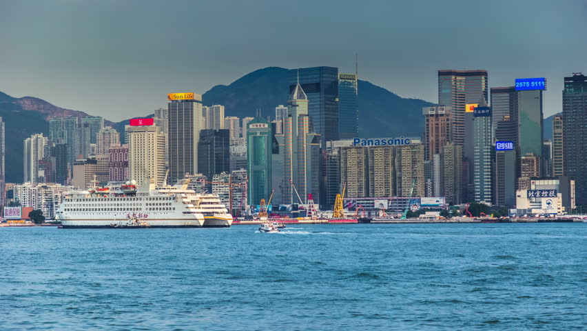 Hong Kong's Victoria Harbour, the tall buildings of the financial business district. 4K TimeLapse - August 2016, Hong Kong | Shutterstock HD Video #20624935