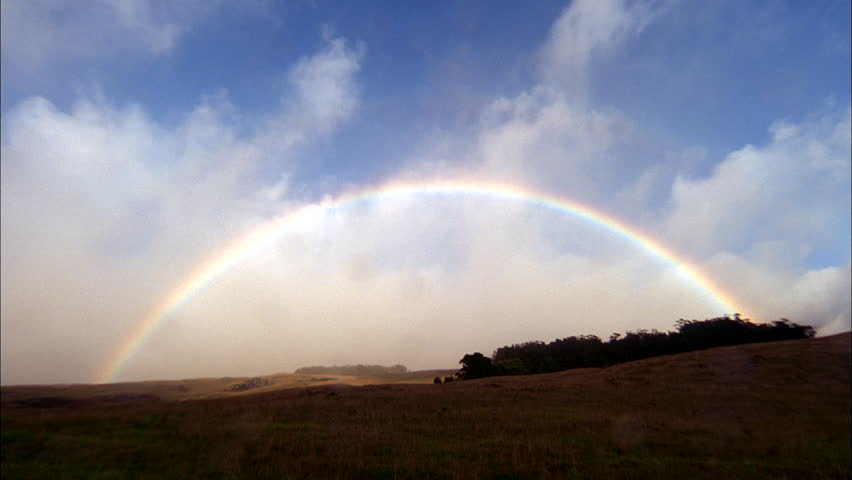 Day Timelapse Rainbow clouds over field green trees prairie Rain passes thru, drops rain lens | Shutterstock HD Video #20718355