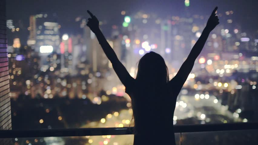 Young beautiful woman dancing on terrace during night. Young excited woman dancing on the rooftop, enjoying breathtaking view over the city at night. City lights, Party time.   | Shutterstock HD Video #20788897