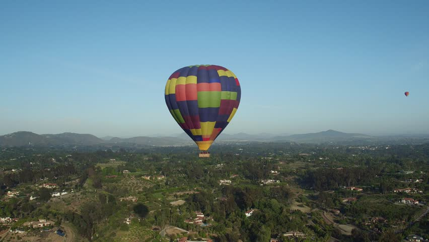 Hot Air Balloon floats across the sky and over residential area in San Diego, Del Mar and Encinitas, Rancho Santa Fe, California  | Shutterstock HD Video #20809354