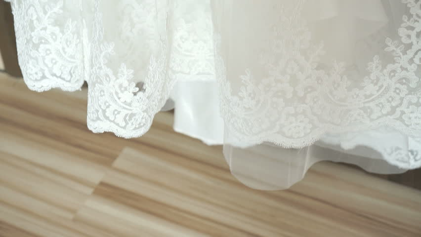 Wedding dress hanging on a shoulders indoors | Shutterstock HD Video #20835589