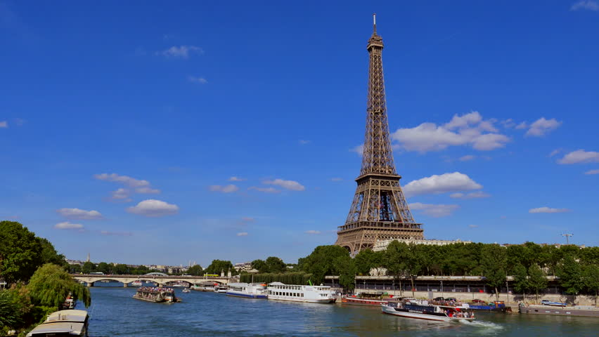 Cruise Ship On Seine River By Buildings In City Against Clear Sky, Paris, France | Shutterstock HD Video #20854291