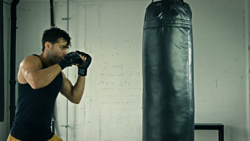 Athletic Male Working Out. Boxing. Slow Motion. | Shutterstock HD Video #20899561