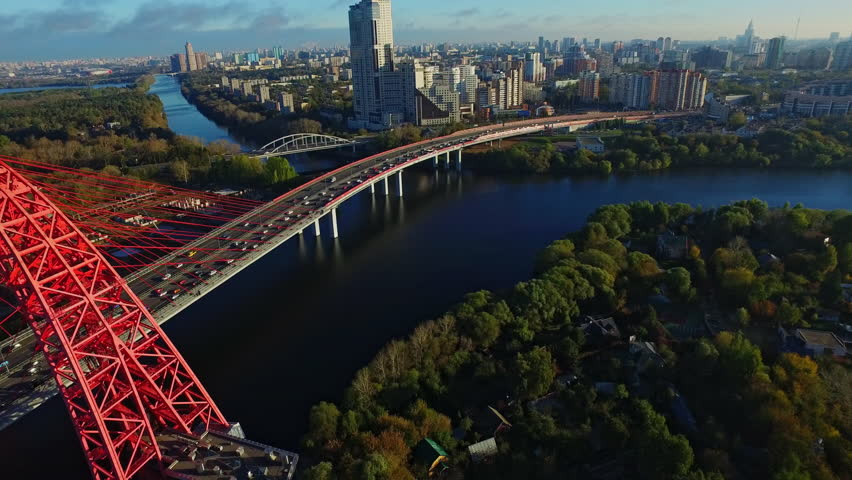 WS AERIAL POV Cityscape with red bridge called Zhivopisny Bridge over Moskva River / Moscow, Russia (October, 2015- Moscow, Russia) | Shutterstock HD Video #20958970