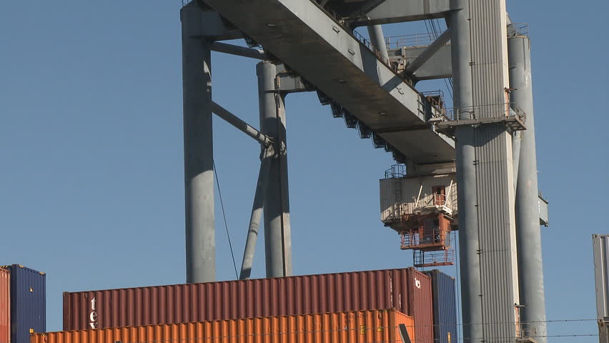 Large cranes moving containers at the port - HD stock footage clip