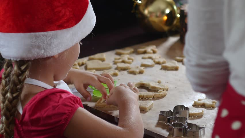 Mother and daughter are preparing gingerbread for Christmas | Shutterstock HD Video #21016993