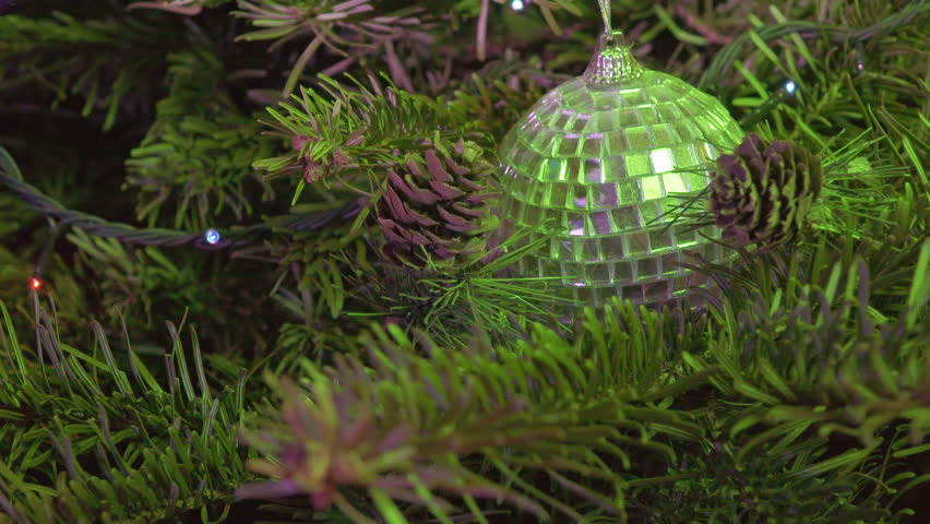 New Year's ball against the background of the decorated garland of a Christmas tree | Shutterstock HD Video #21110908