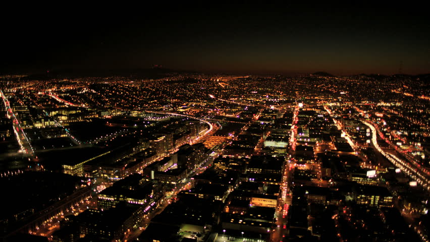 Aerial night illuminated cityscape view of rolling city streets and districts, San Francisco, North America, USA